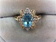 Blue Topaz Lady's Stone & Diamond Ring 8 Diamonds .08 Carat T.W.