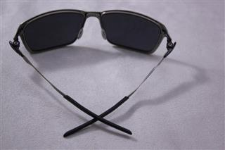 white and black oakley sunglasses  black/black