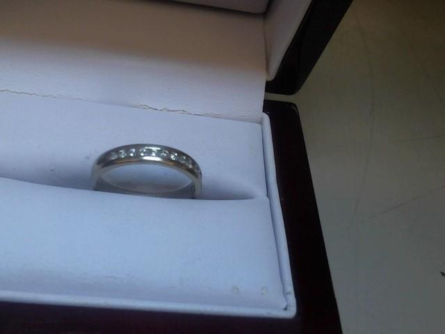 Lady's Diamond Wedding Band 14 Diamonds .14 Carat T.W. 14K Yellow Gold 2.5g