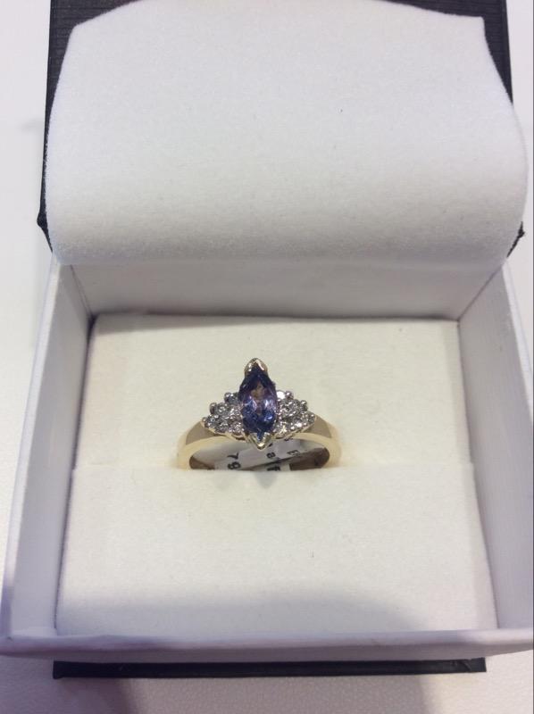 Synthetic Tanzanite Lady's Stone & Diamond Ring 12 Diamonds .12 Carat T.W.