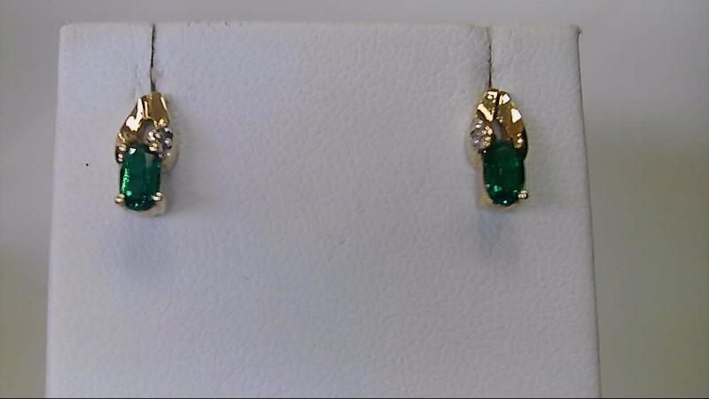 Lady's 10k yellow gold oval synthetic emerald -diamond earrings