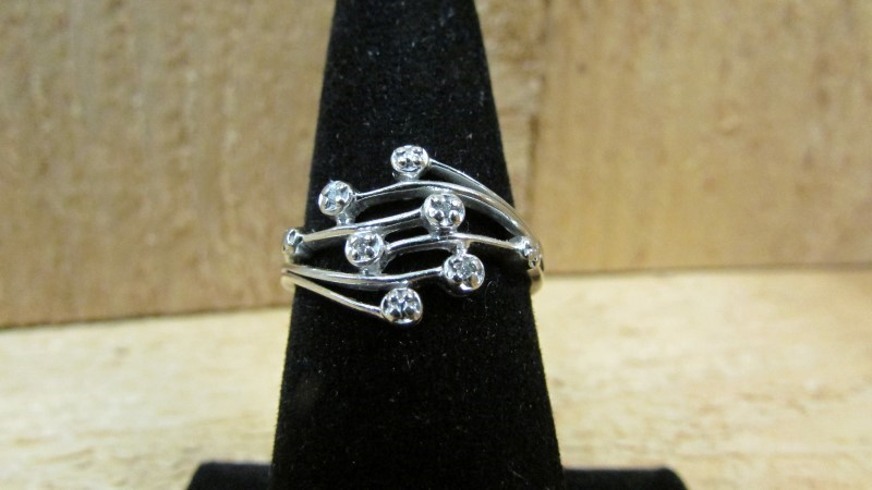 Lady's Diamond Fashion Ring 4 Diamonds .04 Carat T.W. 10K White Gold 2.2g