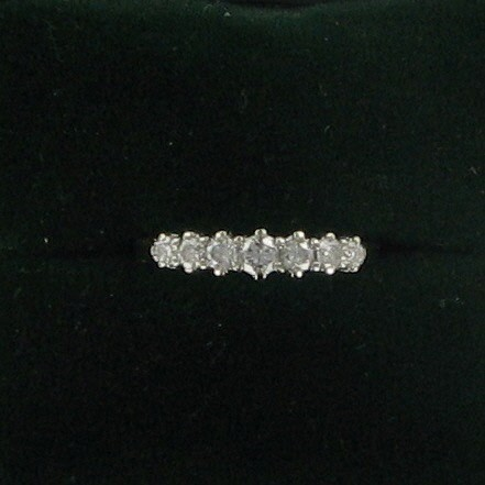 Lady's Diamond Wedding Band 7 Diamonds .31 Carat T.W. 14K Yellow Gold 1.6dwt