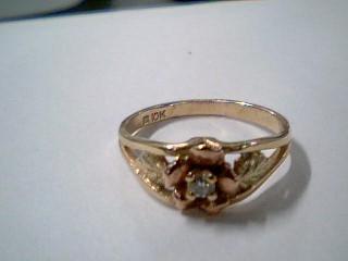 Lady's Diamond Fashion Ring 2 Diamonds .14 Carat T.W. 10K Tri-color Gold 1.9g