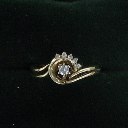 Lady's Diamond Fashion Ring .10 CT. 14K Yellow Gold 3.1dwt