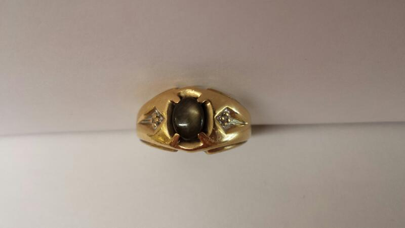 10k Yellow Gold Ring with 1 Oval Cats-eye stone with 2 Diamond Chips