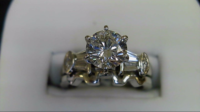 Lady's 14k white gold 1.05ct round diamond/baguette wed set