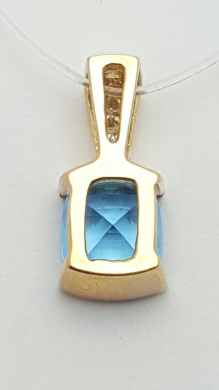 Blue Topaz Gold-Diamond & Stone Pendant 3 Diamonds .03 Carat T.W. 14K Yellow Gol