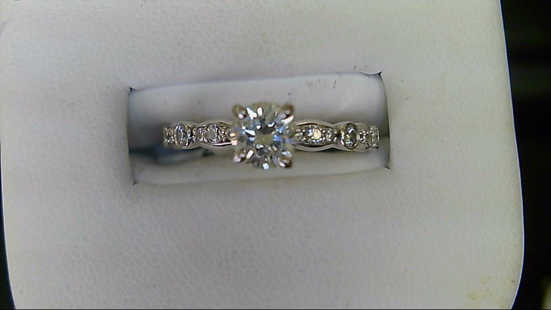ESTATE WG .55CT (J VS2) ROUND DIAMOND WITH 1/4CTTW ROUND DIAMOND IN MOUNTING LAD