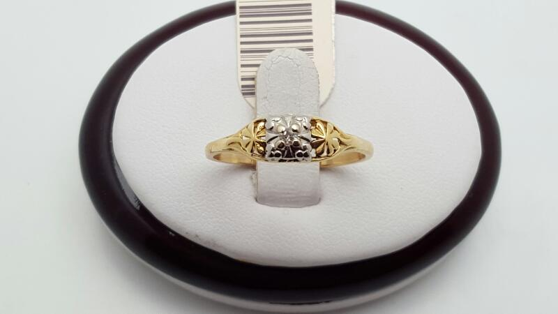 Lady's Diamond Solitaire Ring .03 CT. 14K Yellow Gold 1.9g