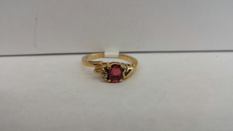 14k Yellow Gold Ring with 1 Red Oval Stone and 2 Diamond Chips