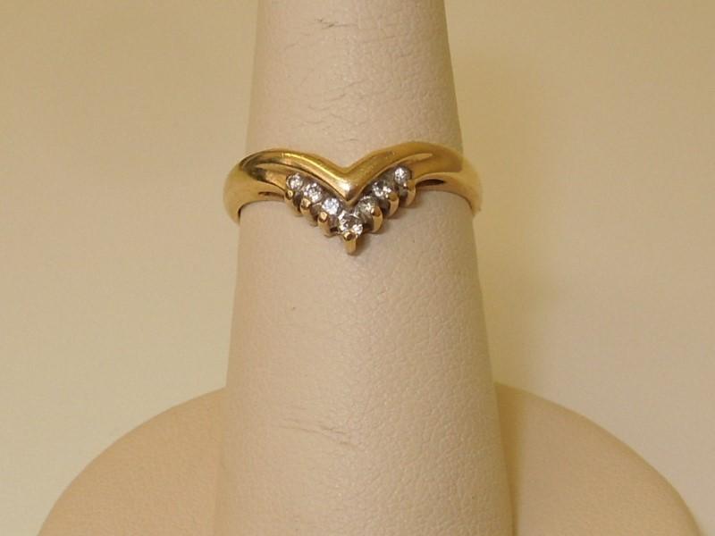 Lady's Diamond Cluster Ring 7 Diamonds .14 Carat T.W. 14K Yellow Gold 1.9g