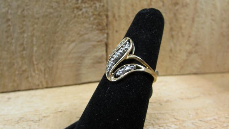 Lady's Diamond Fashion Ring 7 Diamonds 0.07 Carat T.W. 10K Yellow Gold 2.6g
