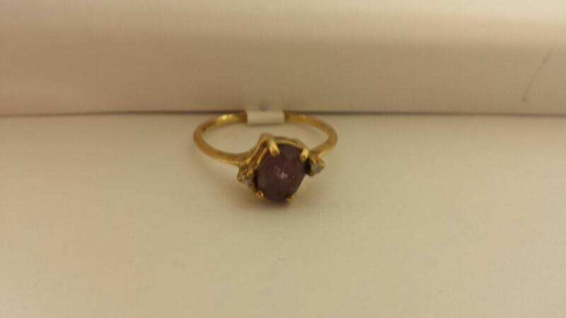10k Yellow Gold Ring with a Purple Stone