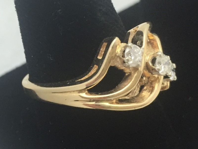 Lady's Diamond Fashion Ring 3 Diamonds .30 Carat T.W. 14K Yellow Gold 3.5dwt