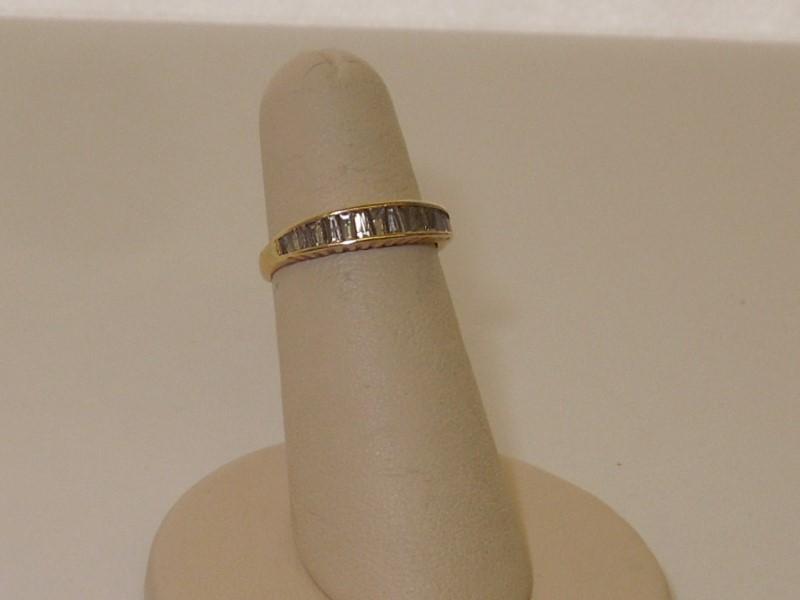 Lady's Diamond Wedding Band 15 Diamonds .60 Carat T.W. 14K Yellow Gold 1.8g