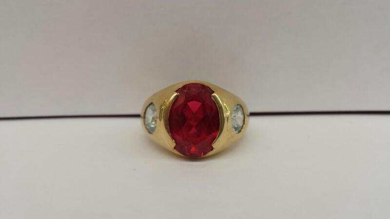 14k Yellow Gold Ring with 1 Oval Red Stone and 2 Round Teal Stones