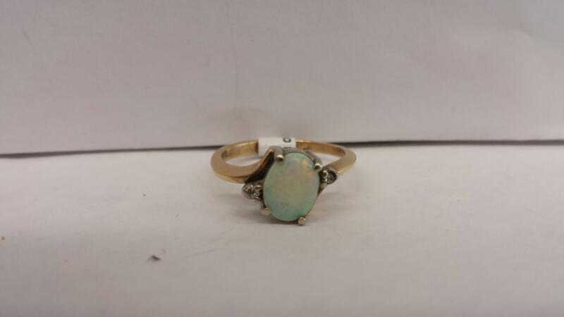 14k Yellow Gold Ring with 1 Opal and 2 Diamond Chips