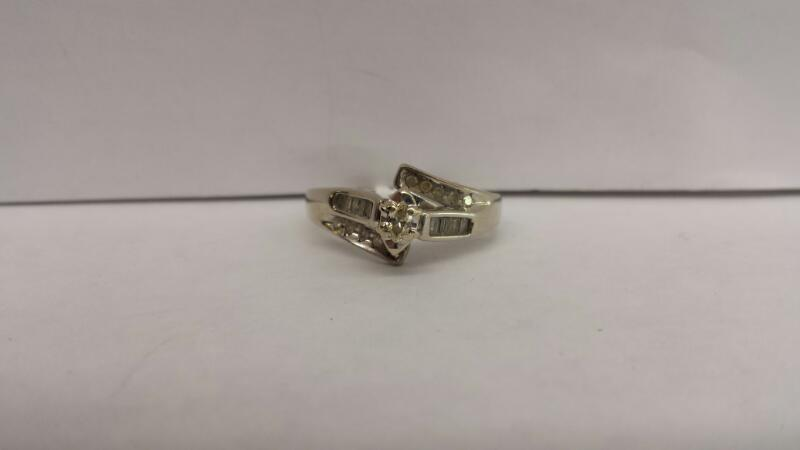 10k White Gold Ring with 1 Marquise Diamond and 10 Diamond Chips