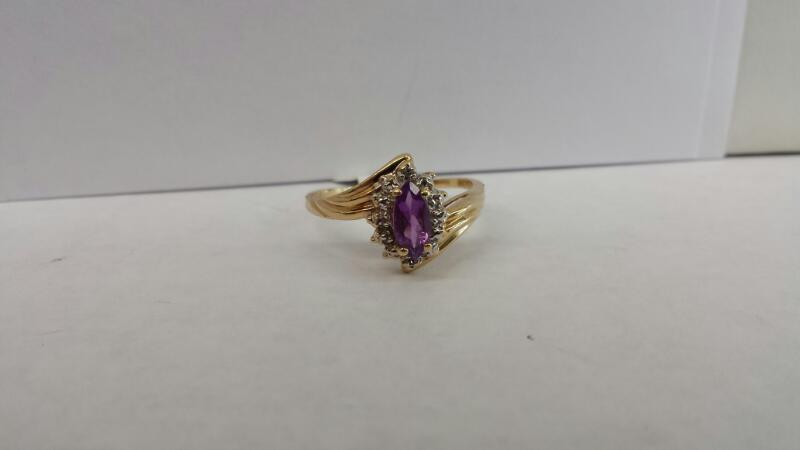 10k Yellow Gold Ring with 1 Purple Stone and 2 Diamond Chips