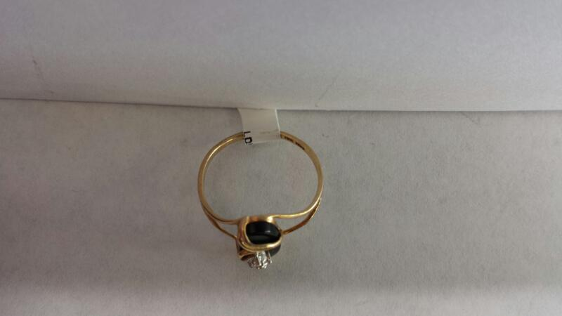 10k Yellow Gold Ring with a Black Stone and 1 Diamond Chip