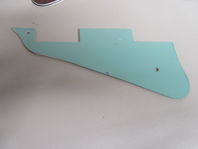 LOT OF FIVE (5) PICKGUARDS AND ONE CONTROL PLATE COVER FOR GIBSON STYLE GUITARS.