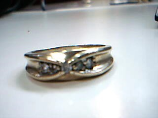 Lady's Diamond Fashion Ring 5 Diamonds .05 Carat T.W. 10K Yellow Gold 3.7g