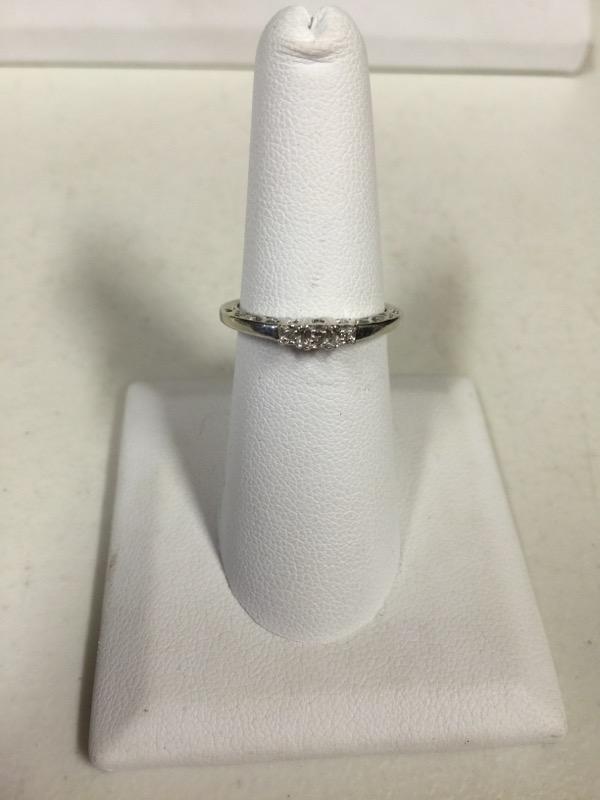 Lady's Diamond Solitaire Ring 3 Diamonds .09 Carat T.W. 10K White Gold 1.5g