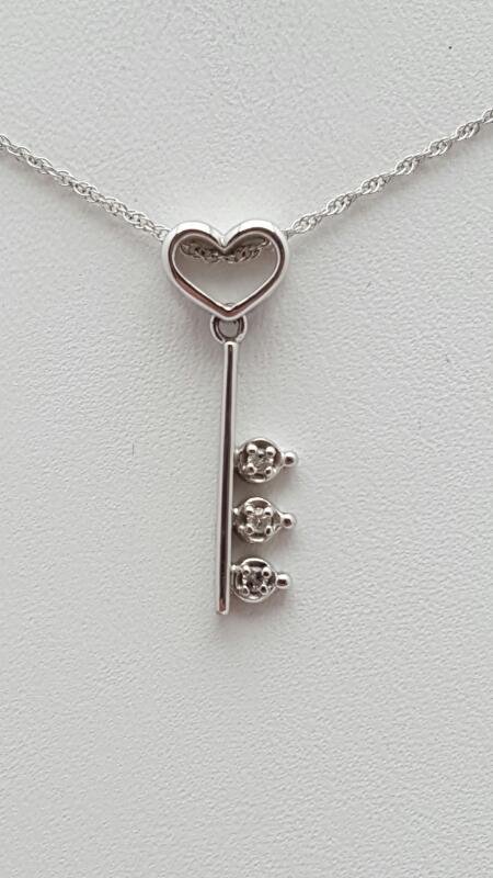 "18"" Diamond Necklace 3 Diamonds .03 Carat T.W. 10K White Gold 1.3g"