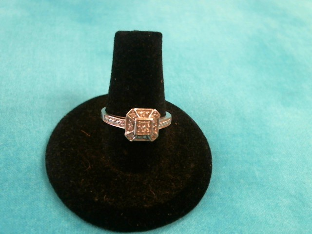 Lady's Diamond Cluster Ring 16 Diamonds .16 Carat T.W. 10K White Gold 1.7dwt