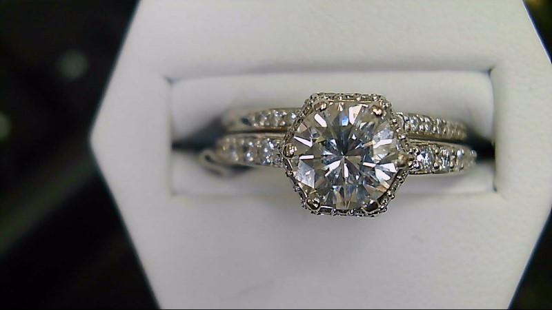 lady's 14kwg 1.09ct rd with 60-.01ct rd halo wed set