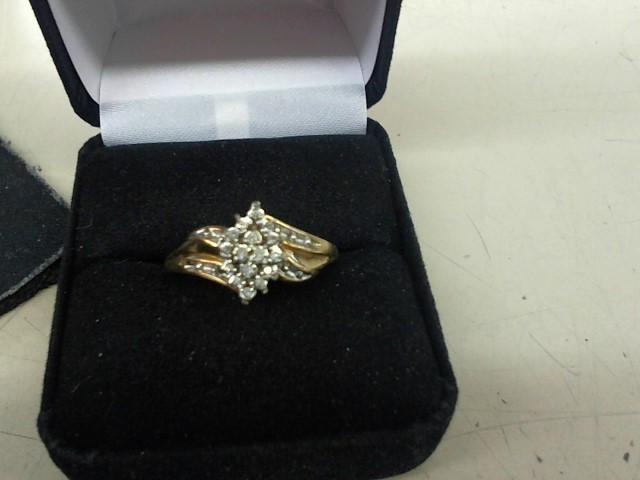 Lady's Diamond Cluster Ring 16 Diamonds .16 Carat T.W. 10K Yellow Gold 3.5g