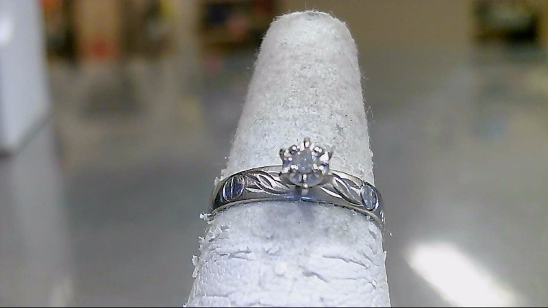Lady's Diamond Solitaire Ring .07 CT. 10K White Gold 1.8g
