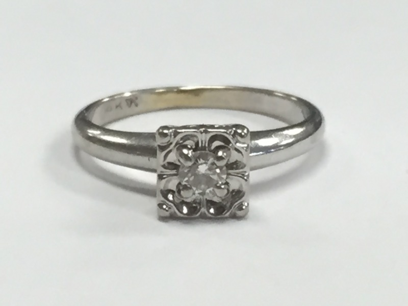 Lady's Diamond Solitaire Ring .10 CT. 14K White Gold 2.66g Size:6.3