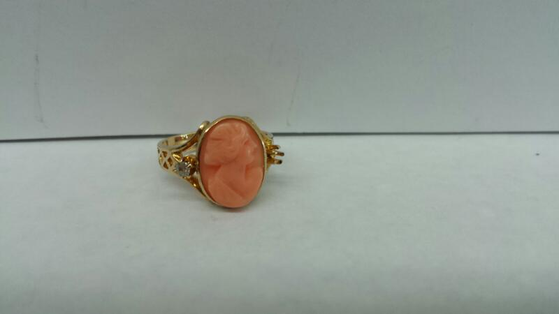10k Yellow Gold Ring with Pink Stone and 1 Diamond Chip