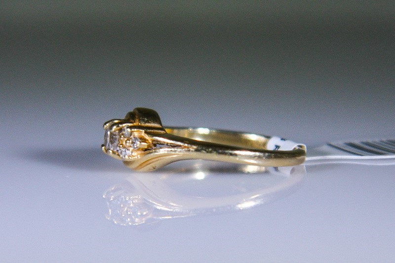 Lady's Diamond Engagement Ring 7 Diamonds .16 Carat T.W. 14K Yellow Gold 3g