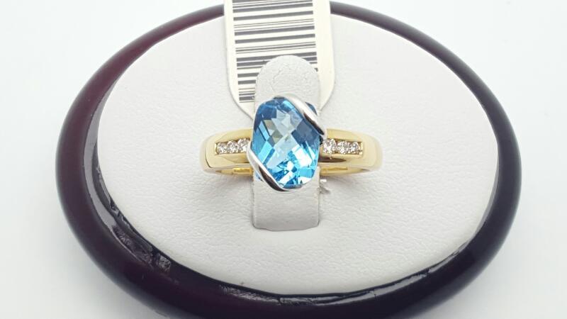 Blue Topaz Lady's Stone & Diamond Ring 6 Diamonds .12 Carat T.W.