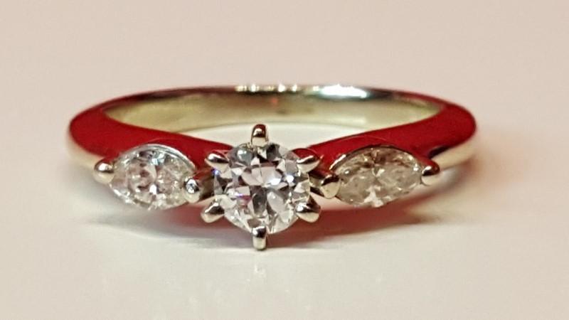 Lady's Diamond Solitaire Ring 3 Diamonds .27 Carat T.W. 14K Yellow Gold 3g