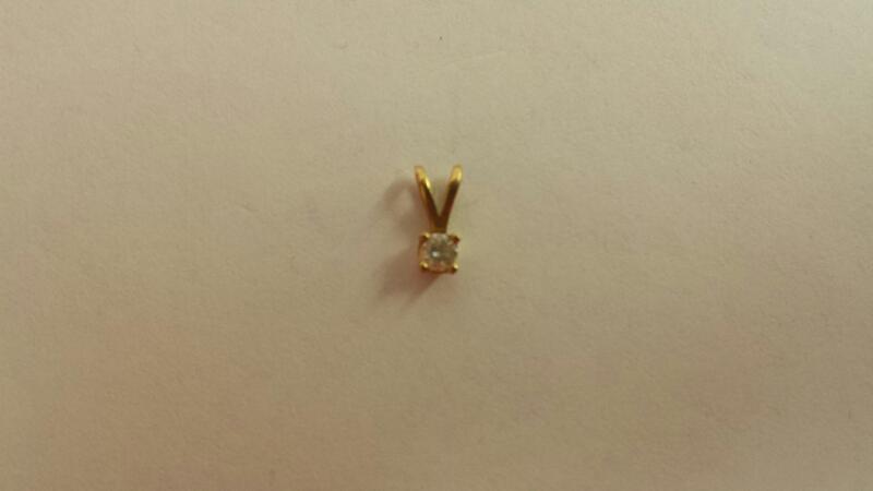 14k Yellow Gold Pendant with One .05CT Diamond