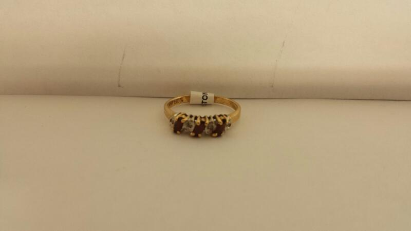 10k Yellow Gold Ring with 3 Red Stones and 4 Diamond Chips