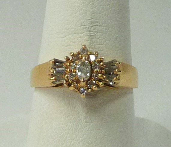 Lady's Diamond Fashion Ring 17 Diamonds .68 Carat T.W. 14K Yellow Gold 2.47dwt
