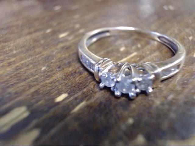 Lady's Diamond Cluster Ring 9 Diamonds .15 Carat T.W. 10K Yellow Gold 1.7g