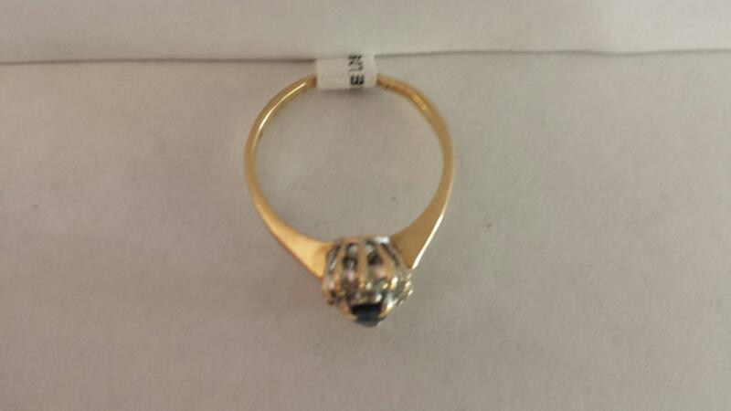 14k Yellow Gold Ring with 1 Blue Stone and 12 Diamond Chips