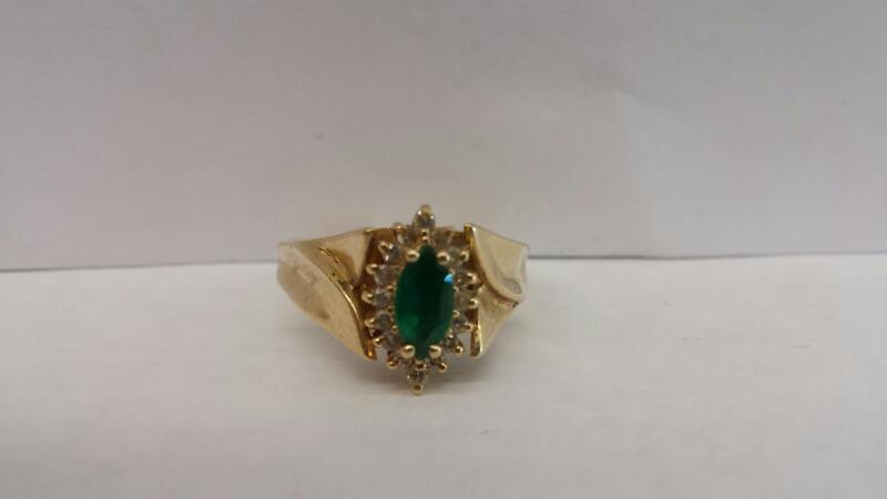 14k Yellow Gold Ring with 1 Emerald Stone and 16 Diamond Chips