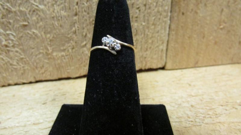 Lady's Diamond Fashion Ring 3 Diamonds .04 Carat T.W. 10K Yellow Gold 1.1g