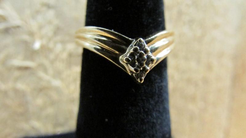Lady's Diamond Fashion Ring 4 Diamonds .04 Carat T.W. 14K Yellow Gold 2.2g Size: