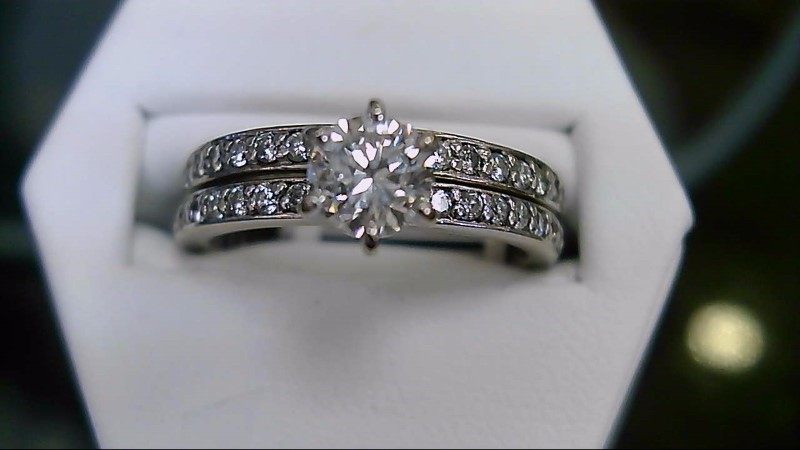 Lady's 14k white gold 1/2ct center with round diamonds eternity set sz 7
