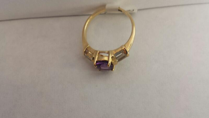 10k Yellow Gold Ring with 1 Purple Stone and 6 Baguettes