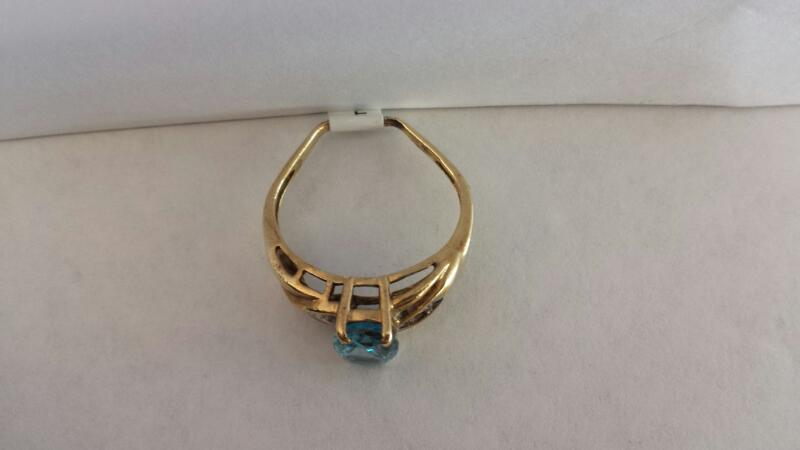 10k Yellow Gold Ring with Blue Oval Stone and 3 Diamond Chips