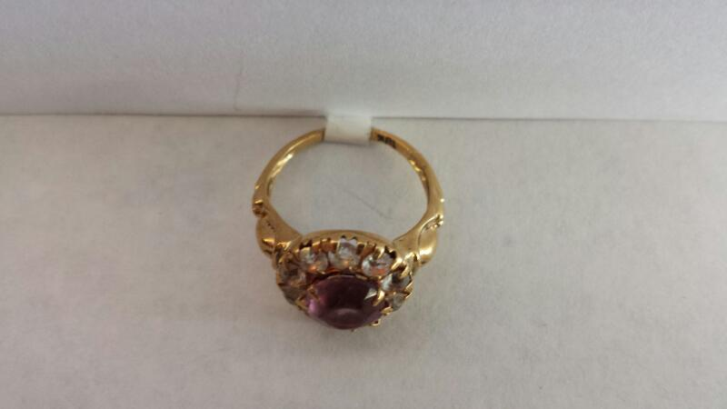 10k Yellow Gold Ring with 1 Purple Stone and 10 Clear Stones
